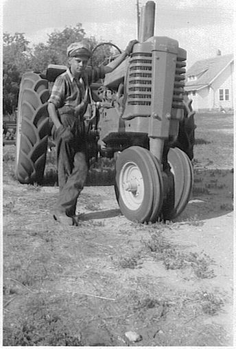 My dad in his teens with his John Deere A.