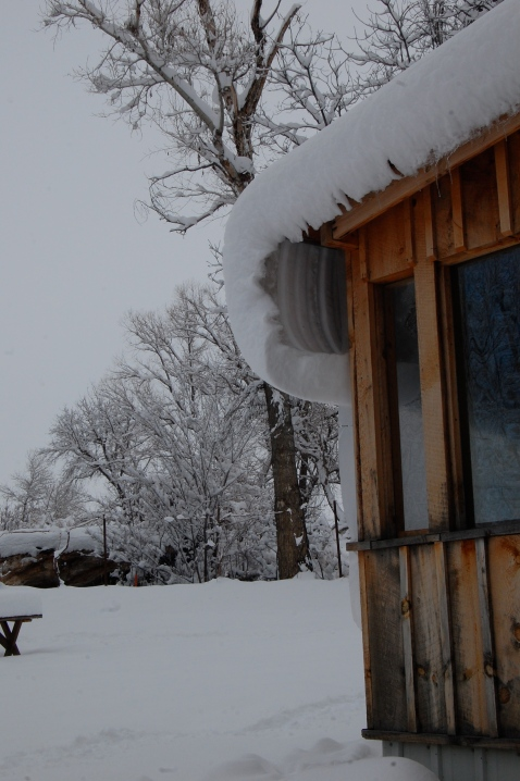 The curl of snow around the roof of the Sunflower Room porch